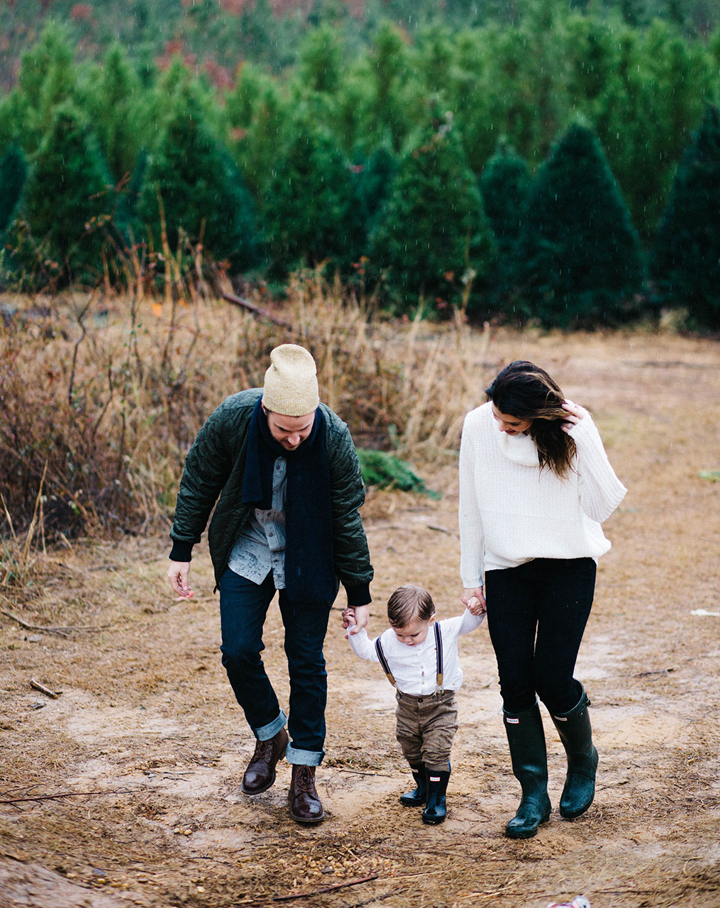 young family in woods walking